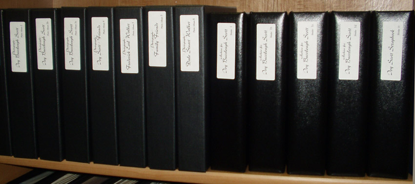 shelved binders containing archived documents
